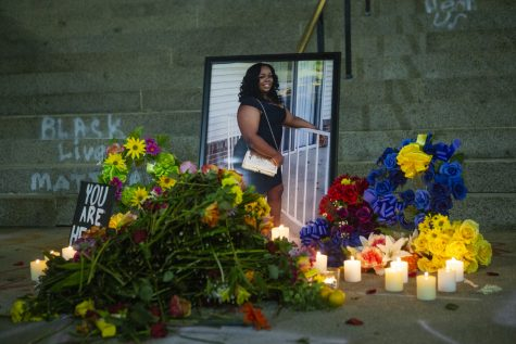 A memorial for Breonna Taylor is seen on Friday, June 5 at the bottom of the Old Capitol building steps. Protesters lined up to place flowers in front of a photo of Taylor, who was killed by police in her home on March 13, 2020. The crowd sang Happy Birthday to her on I-80 as well as on the Pentacrest lawn, as today would have been her 27th birthday.
