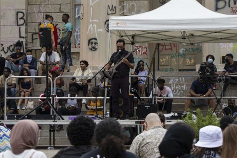Iowa City jazz musician Blake Shaw performs on Saturday, June 20 at the Pentacrest. The Iowa Freedom Riders hosted a celebration to commemorate Juneteenth, the anniversary of when the last enslaved people were freed. (Hannah Kinson/The Daily Iowan)