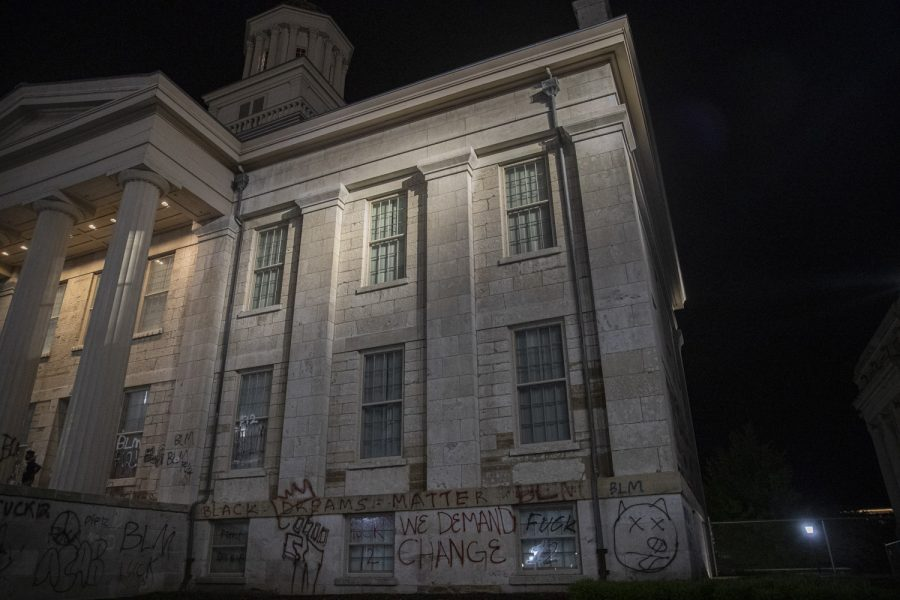 The Old Capitol in downtown Iowa City is seen after the completion of a march to support the Black Lives Matter movement and protest police brutality on Thursday, June 4. Protesters added to the graffiti from previous nights and small groups stayed behind after the crowd dispersed to take photos and continue spray painting.