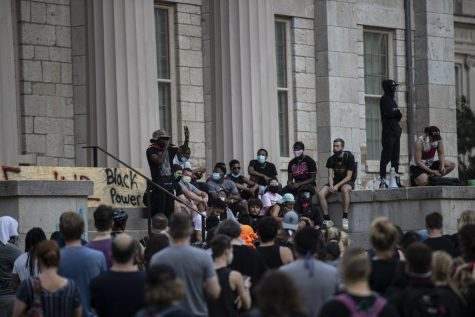 Organizer Mazin Mohamedali speaks to a crowd from the steps of the Old Capitol on Thursday, June 4 in Iowa City before beginning a march to support the Black Lives Matter movement and protest police brutality. Everyone met on the Pentacrest at 7 p.m. and then heard a handful of speeches before starting.