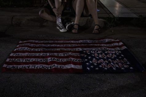 An American flag painted by an Iowa City resident with the names of Black people killed by the police is seen on Saturday, July 4, 2020 on Linn Street in Iowa City. After multiple speakers shared personal stories of inequality at the Pentacrest, protesters celebrated an unveiling of a mural by Robert Moore and Dana Harrison that showcases support for Black lives.