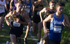The University of Iowa's Spencer Smith attempts to pass Drake University's Kevin Kelly during the Hawkeye Invitational on Friday, Sept. 6, 2019 at the Ashton Cross Country Course. The Hawkeyes prevailed over six other teams to win first place overall in the men's and women's races. Smith finished in 7th place with a time of 18:25.3, while Kelly placed 14th overall.