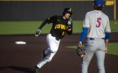 Iowa infielder Dylan Nedved rounds the bases during a baseball game between the Iowa Hawkeyes and the Kansas Jayhawks on Tuesday, March 10, at Duane Banks Field. The Hawkeyes defeated the Jayhawks, 8-0.