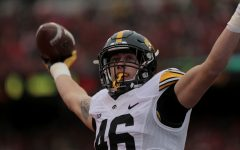 Iowa tight end George Kittle holds up the ball after scoring a touchdown during the Iowa-Nebraska game at Memorial Stadium on Friday, Nov. 27, 2015. Kittle scored the first touchdown of the game.The Hawkeyes defeated the Cornhuskers, 28-20, to finish off a perfect regular season.