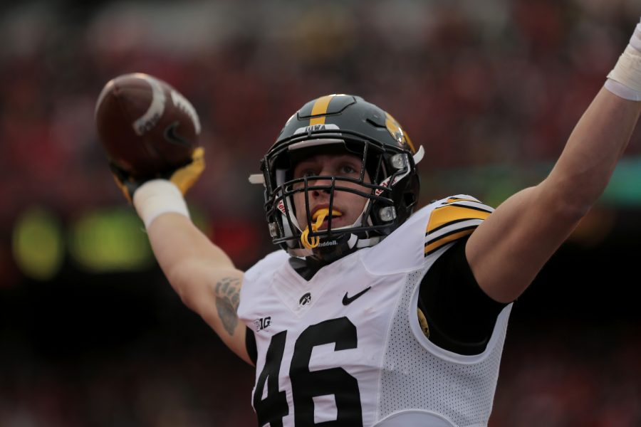 Iowa+tight+end+George+Kittle+holds+up+the+ball+after+scoring+a+touchdown+during+the+Iowa-Nebraska+game+at+Memorial+Stadium+on+Friday%2C+Nov.+27%2C+2015.+Kittle+scored+the+first+touchdown+of+the+game.The+Hawkeyes+defeated+the+Cornhuskers%2C+28-20%2C+to+finish+off+a+perfect+regular+season.