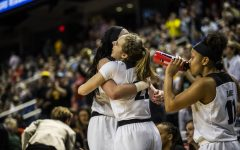 Iowa center Megan Gustafson and guard Kathleen Doyle hug after the win against NC State in the NCAA Sweet 16 game at the Greensboro Coliseum Complex on Saturday, March 30, 2019. The Hawkeyes defeated the Wolfpack 79-61.