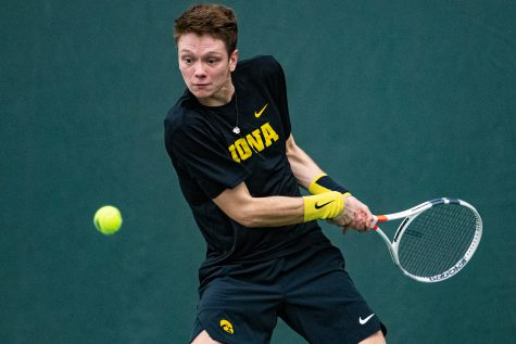 Iowa's Jason Kerst hits a backhand during a men's tennis match between Iowa and Texas Tech at the HTRC on Thursday, Jan. 16, 2020. The Red Raiders defeated the Hawkeyes, 4-3.