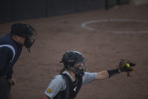 Iowa catcher Kit Rocco catches a pitch during an Iowa softball game against Iowa Central at Pearl Field on Friday, October 4, 2019. The Hawkeyes defeated the Tritons 4-0 in 10 innings.
