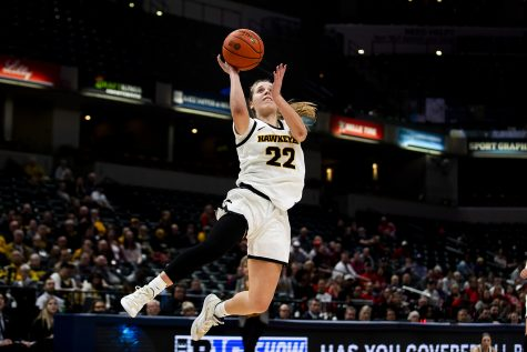 Iowa guard Kathleen Doyle jumps for a lay-up during the Iowa vs. Ohio State Women's Big Ten Tournament game at Bankers Life Fieldhouse in Indianapolis on Friday, March 6, 2020. The Buckeyes defeated the Hawkeyes 87-66.