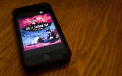 Cover art for On A Sunbeam, a graphic novel by Tillie Walden, is seen from a phone screen on Thursday, July 23, 2020. On A Sunbeam is one of many titles included on the reading list for a new LGBTQ+ book club on campus.