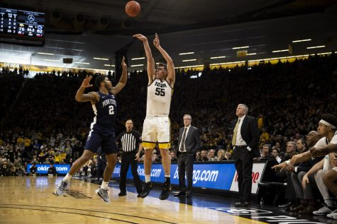 Iowa center Luka Garza takes a shot during a men's basketball game between Iowa and Penn State on Saturday, Feb. 29 at Carver-Hawkeye Arena. The Hawkeyes defeated the Nittany Lions 77-68.
