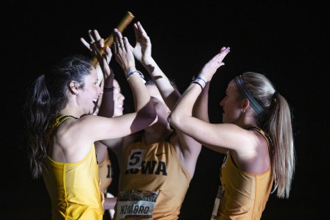 Iowa's Mallory King high fives 4x400m relay premier teammates Davicia Patterson, Jenny Kimbro, and Aly Weum during the Larry Wieczorek Invitational at the University of Iowa Recreation Building on Jan. 18, 2020. The group took second in the premier with a 3:39.67.