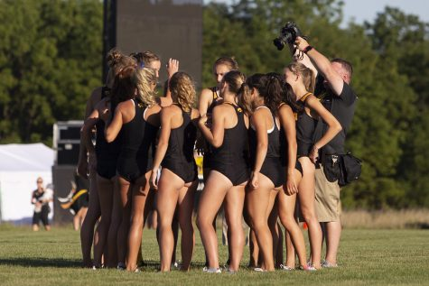 The University of Iowa womenÕs cross country team huddles up prior to the 4000 meter race during the Hawkeye Invitational on Friday, Sept. 6, 2019 at the Ashton Cross Country Course. The Hawkeyes prevailed over six other teams to win first place overall in the menÕs and womenÕs races. Iowa State University runner Abby Caldwell finished in first place with a time of 14:02.