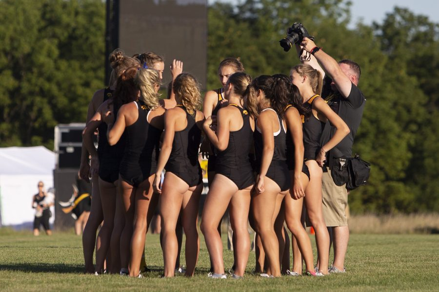 The+University+of+Iowa+women%C3%95s+cross+country+team+huddles+up+prior+to+the+4000+meter+race+during+the+Hawkeye+Invitational+on+Friday%2C+Sept.+6%2C+2019+at+the+Ashton+Cross+Country+Course.+The+Hawkeyes+prevailed+over+six+other+teams+to+win+first+place+overall+in+the+men%C3%95s+and+women%C3%95s+races.+Iowa+State+University+runner+Abby+Caldwell+finished+in+first+place+with+a+time+of+14%3A02.
