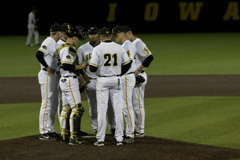 Iowa players meet on the pitcher's mound during the game against Michigan State at the Duane Banks Baseball Stadium on Friday, May 10, 2019. The Hawkeyes defeated the Spartans 7-5.