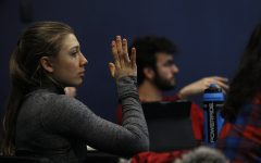 Student-Athlete Constituency Senator Marissa Mueller raises her hand in response to a question given by Dr. Maria Bruno during a UISG meeting at the Iowa Memorial Union on Thursday, February 18, 2020.