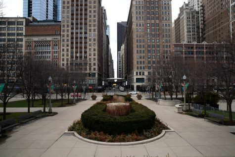 An empty plaza in Millennium Park sits adjacent to the sparsely populated intersection of Madison Street and Michigan Avenue on Tuesday, March 21, 2020 in Chicago, Illinois.