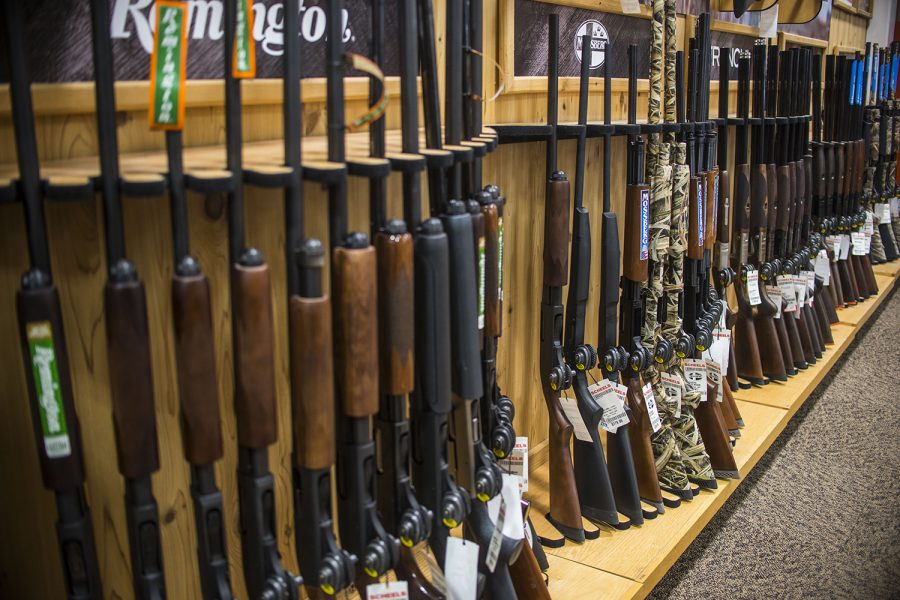 Guns are displayed at Scheels in Coralville on Tuesday, April 11, 2018.