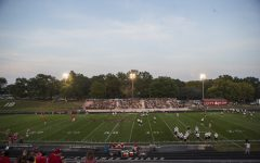 City and West players warmup before a 4A varsity high school football game between Iowa City High and West High at Bates Field in Iowa City on Friday, Sept. 15, 2017.