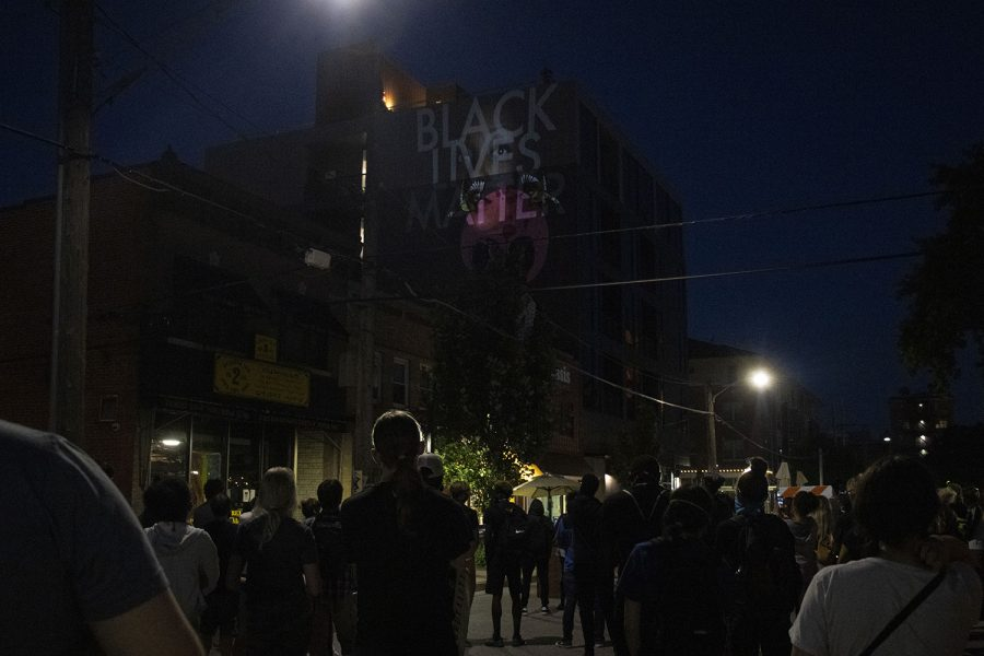 Protesters+gather+to+commemorate+a+new+mural+that+celebrates+Black+lives+on+Saturday%2C+July+4%2C+2020+on+Linn+Street+in+Iowa+City.+After+multiple+speakers+shared+personal+stories+of+inequality+at+the+Pentacrest%2C+protesters+walked+to+Linn+Street+to+celebrate+an+unveiling+of+a+mural+by+Robert+Moore+and+Dana+Harrison.+