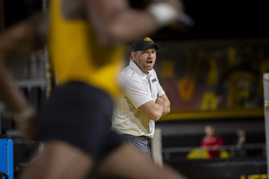 Iowa Director of Track and Field Joey Woody coaches from the infield during the 4x400m relay during the Larry Wieczorek Invitational at the University of Iowa Recreation Building on Jan. 18, 2020.
