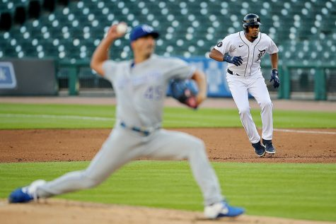 Detroit Tigers third baseman Jeimer Candelario (46) leads off first base as Kansas City Royals pitcher Kyle Zimmer (45) throws a pitch during their MLB game at Comerica Park in Detroit, on Tuesday, July 28, 2020.