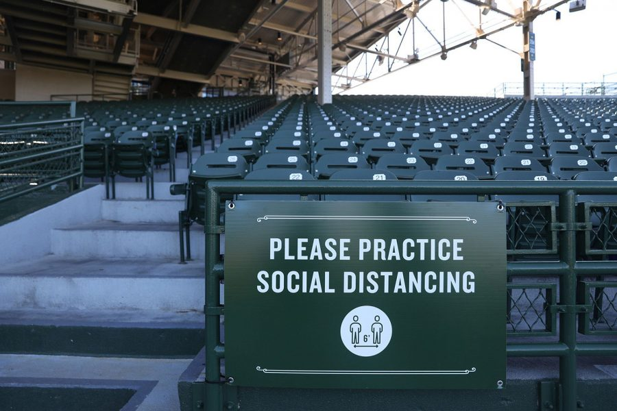 A sign reminding photographers to social distance is seen in the stands at Wrigley Field in Chicago, Ill. (Chris Sweda/Chicago Tribune/TNS)