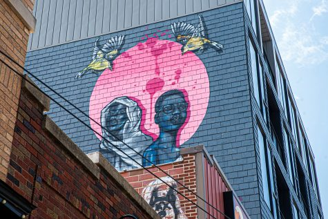 A mural painted by Robert Moore and Dana Harrison is seen atop Oasis in Iowa City on Thursday, July 2, 2020. The mural was finished within 24 hours on June 25, as a celebration of black lives and equality in Iowa City.
