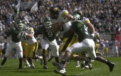 Nathan Chandler is sacked by MSU linebacker Mark Goebel during the second quarter of play.  Chandler had 9 carries for negative 24 yards. Nicholas Wynia/The Daily Iowan