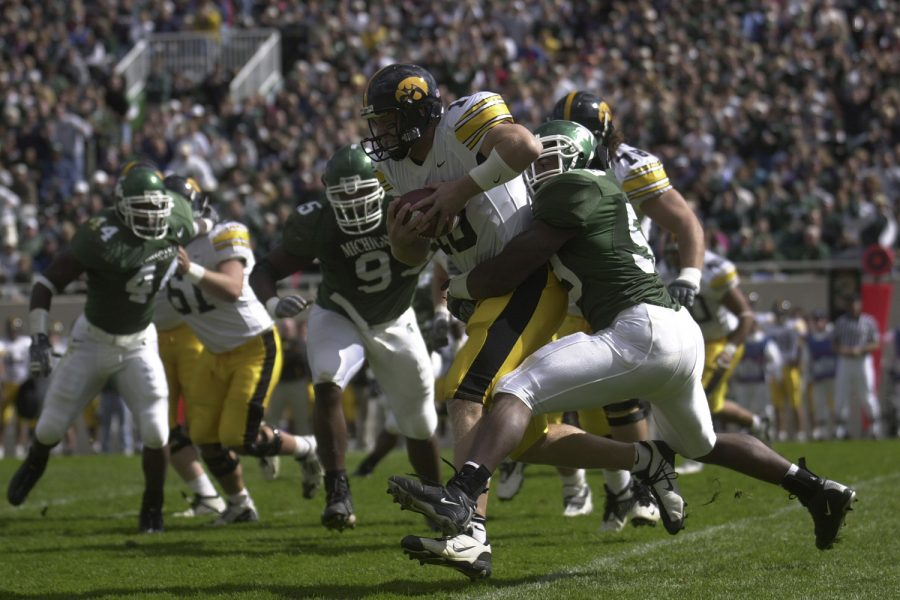 Nathan+Chandler+is+sacked+by+MSU+linebacker+Mark+Goebel+during+the+second+quarter+of+play.++Chandler+had+9+carries+for+negative+24+yards.+Nicholas+Wynia%2FThe+Daily+Iowan