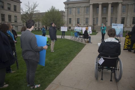 Rally attendees hold signs and listen to speakers on the Pentacrest on Wednesday, May 1, 2019. UI Students for Disability Advocacy & Awareness organized this rally to speak about the injustice that students with disabilities face on campus.