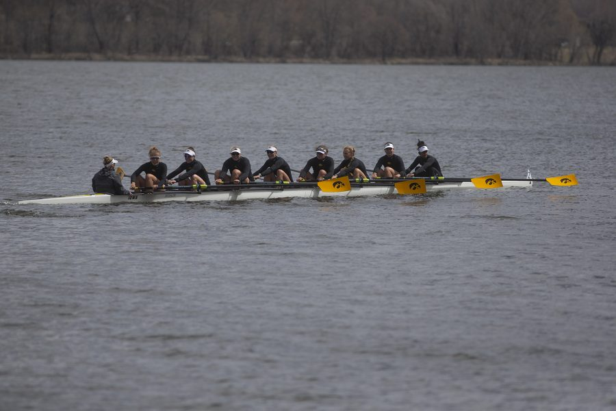 The+Iowa+varsity+8+crew+looks+to+their+supporters+on+the+shore+as+they+row+back+to+the+dock+at+the+end+of+the+first+session+of+a+women%27s+rowing+meet+on+Lake+MacBride+on+Saturday+April+13%2C+2019.+Iowa+won+3+out+of+12+races+with+the+varsity+8+crew+winning+both+races+for+the+day.