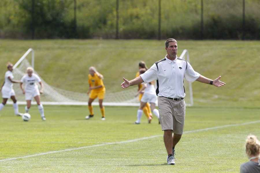 Iowa head coach Ron Rainey reacts to the team's passing against North Dakota at the Iowa Soccer Complex in Iowa City on Sunday, August 19, 2012. The Hawkeyes recorded a 3-0 victory over UND.