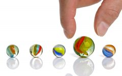 Picking up a big marble concept for choice or advantage