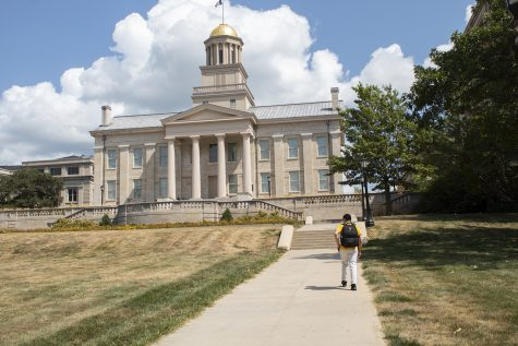 Pictured on Aug. 27, 2020, is a student walking through campus to their classes during the first week of school at the University of Iowa. Although school looks different this year, students are still on campus attending some in-person classes. (Grace Smith/The Daily Iowan)