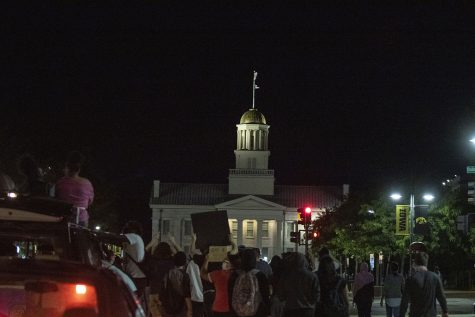Protesters march back to the Old Capitol Building during a Black Lives Matter protest organized by the Iowa Freedom Riders on Sunday, Aug. 30, 2020. This was the third protest of a four day protest streak in which protesters took to the street to put pressure on the City Council. These protests lead up to a Tuesday meeting during which three of their demands will be discussed.