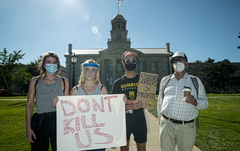 Protesters Ayla Kanin, Eva Sileo, Zach Grewe, and Joe McKenna pose for a portrait in front of the Old Capitol Building in downtown Iowa City on Wednesday, Aug. 19, 2020. The Campaign to Organize Graduate Students (COGS) led a march to President Bruce Harreld's home in order to protest the administration's insistence that the university remain open despite the health risk posed by COVID-19.