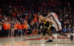 Iowa guard Connor McCaffery drives past Illinois' Da'Monte Williams during a game on Sunday, March 8, 2020 at the State Farm Center in Champaign, Ill. The Hawkeyes lost to the Fighting Illini, 76-78.