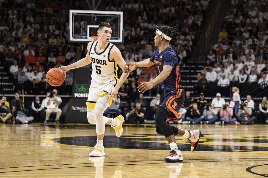 Iowa guard CJ Fredrick attempts to take the ball past Illinois  guard Trent Frazier during a men's basketball game between the Iowa Hawkeyes and the Illinois Fighting Illini on Sunday, February 2, 2020. The Hawkeyes defeated the Fighting Illini 72-65.