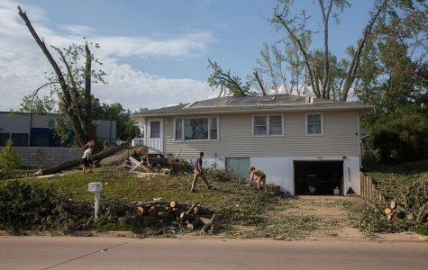The Welsh family works to clean up their yard three days after sustaining significant damage from the derecho that swept through Iowa on Monday, August 10. The majority of the damage was caused by large branches falling from the tree next to their house, which is located on 33rd Street in Cedar Rapids.