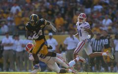 Iowa defensive back Desmond King avoids a tackle from Florida wide receiver Ahmad Fulwood during the Outback Bowl at Raymond James Stadium on Monday, Jan. 2, 2016. The Gators defeated the Hawkeyes, 30-3.