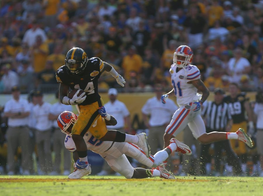 Iowa+defensive+back+Desmond+King+avoids+a+tackle+from+Florida+wide+receiver+Ahmad+Fulwood+during+the+Outback+Bowl+at+Raymond+James+Stadium+on+Monday%2C+Jan.+2%2C+2016.+The+Gators+defeated+the+Hawkeyes%2C+30-3.