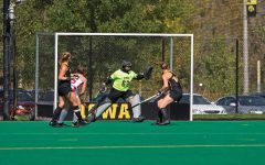 Iowa goalkeeper Grace McGuire blocks a shot on goal during the Iowa field hockey match against Rutgers on Friday, Oct. 4, 2019 at Grant Field. The Hawkeyes beat the Scarlet Knights 2-1.