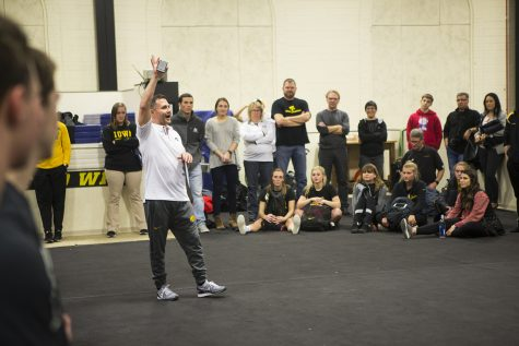Iowa head coach JD Reive talks with attendees before the Black and Gold intrasquad in the Field House on Friday, Dec. 1, 2017. The Hawkeyes menÕs gymnastics team debuted their 2018 roster during the event.
