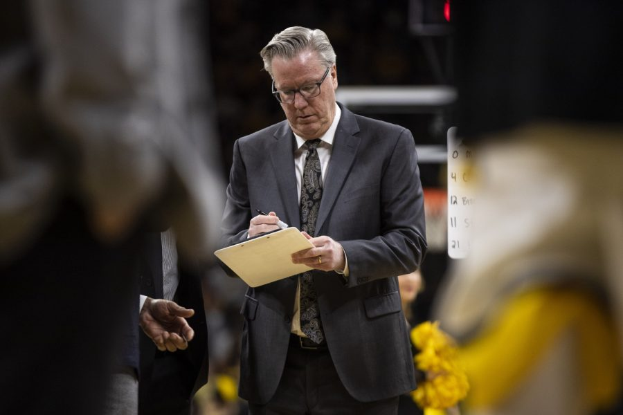 Iowa head coach Fran McCaffery draws up plays during a timeout during a men's basketball game between Iowa and Penn State on Saturday, Feb. 29 at Carver-Hawkeye Arena. The Hawkeyes defeated the Nittany Lions 77-68.