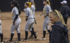 Iowa Head Coach Renee Gillespie walks to join the team during an Iowa softball game against Iowa Central at Pearl Field on Friday, October 4, 2019. The Hawkeyes defeated the Tritons 4-0 in 10 innings.