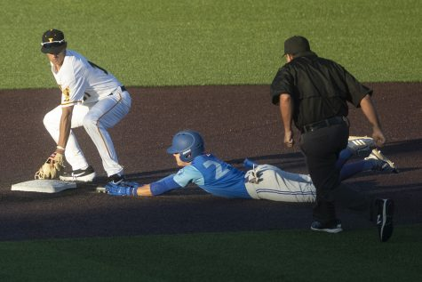 Iowa infielder Dylan Nedved attempts to tag out an Ontario player sliding into second base during the seventh inning of a game against Ontario at Duane Banks Field on Friday, September 13, 2019. Ontario was called safe. The Hawkeyes defeated the Blue Jays  30-6 in 14 innings.