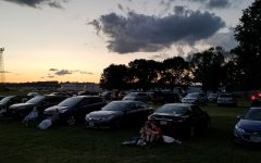 Cars parked on the lawn for the Summer of Arts free movie series, adapted as a drive-in due to the coronavirus pandemic.