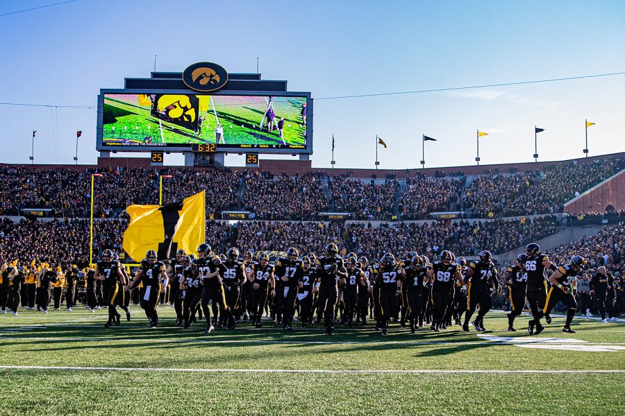 Iowa players run onto the field during a football game between Iowa and Minnesota at Kinnick Stadium on Saturday, Nov. 16, 2019. The Hawkeyes defeated the Gophers, 23-19.