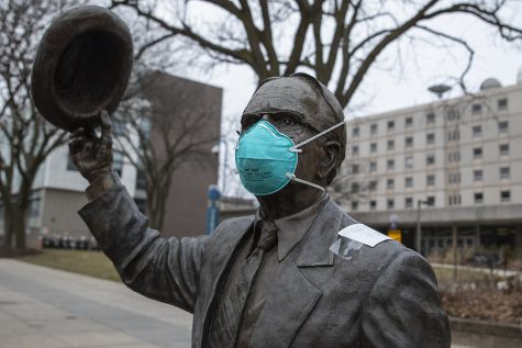 A mask sits on the Irving B. Weber statue in front of Van Allen on Thursday, March 12, 2020.   The US has seen a shortage of N95 surgical masks in the recent weeks due to coronavirus. The CDC currently recommends the use of facemarks be reserved for those who are sick or for those who are caring for the sick.